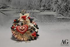 Coroncina decorata con lana e feltro
